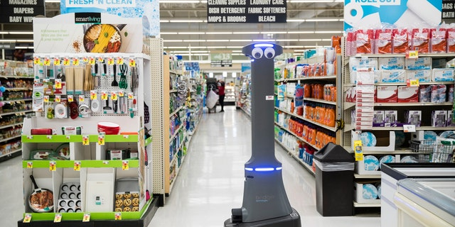 A robot named Marty cleans the floors at a Giant grocery store in Harrisburg, Pa., Tuesday, Jan. 15, 2019.