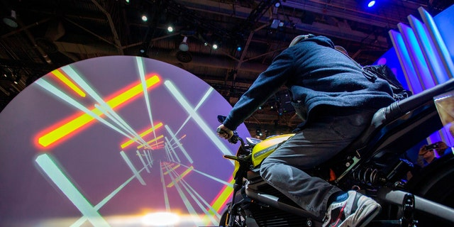 A man tries out a Harley-Davidson LiveWire electric motorcycle at the Panasonic exhibit during CES 2019 in Las Vegas, Nevada on Jan. 8, 2019.
