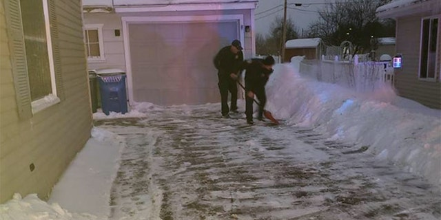 When a pregnant woman went into labor in her living room on a frigid January weekday, some responding firefighters assisted by shoveling her driveway.