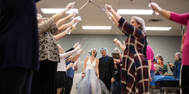 While the reception of 70 people included some dancing, much of it was spent packing meals, Fox 9 reported.