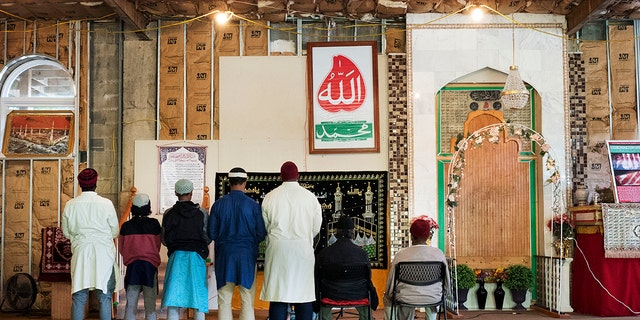 In this Sept. 7, 2017 photo, men pray at the mosque at Islamberg in Tompkins, N.Y.