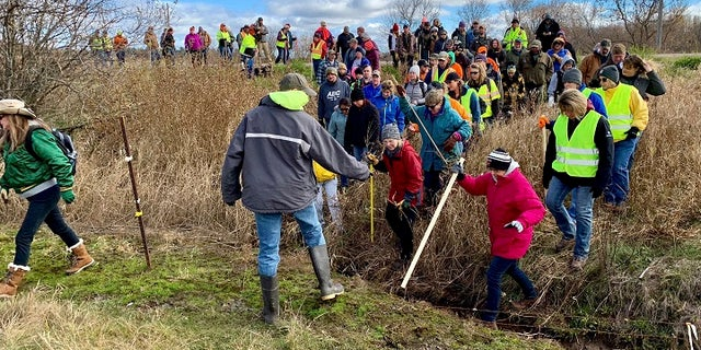 Volunteers search for Jayme Closs near Barron, Wis., who went missing on Oct. 15 after her parents were discovered killed in their home.
