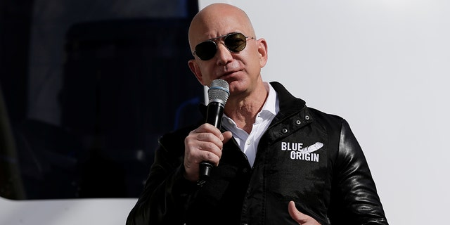 File photo:Amazon and Blue Origin founder Jeff Bezos addresses the media about the New Shepard rocket booster and Crew Capsule mockup at the 33rd Space Symposium in Colorado Springs, Colorado, United States April 5, 2017. REUTERS/Isaiah J. Downing -