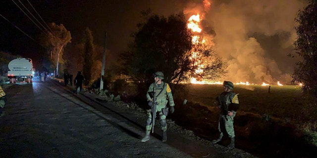 soldiers guard in the area near an oil pipeline explosion in Tlahuelilpan, Hidalgo state, Mexico, Friday, Jan. 18, 2019. (Associated Press)