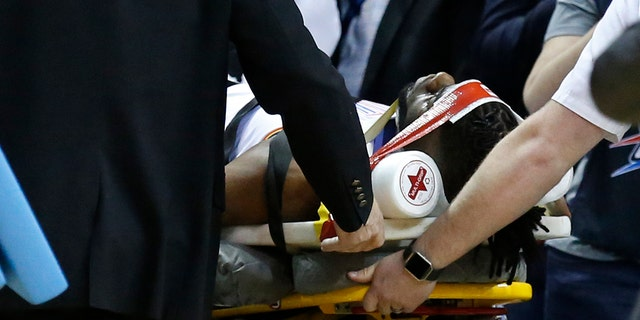 Oklahoma City Thunder forward Nerlens Noel is wheeled off the court on a stretcher in the second half of an NBA basketball game against the Minnesota Timberwolves in Oklahoma City, Tuesday, Jan. 8, 2019.