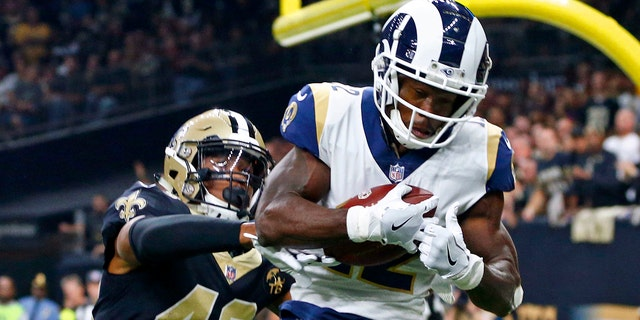 FILE - In this Nov. 4, 2018, file photo, Los Angeles Rams wide receiver Brandin Cooks (12) pulls in a touchdown reception in front of New Orleans Saints free safety Marcus Williams (43) in the first half of an NFL football game in New Orleans. Cooks is the first player in NFL history to have three consecutive 1,000-yard receiving seasons with three different teams.