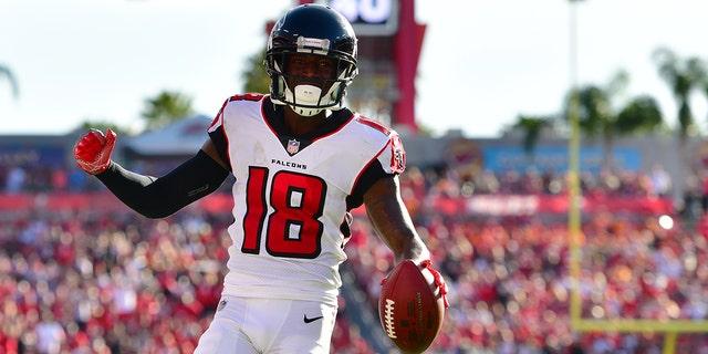 Calvin Ridley of the Atlanta Falcons catches a 7-yard touchdown pass from Matt Ryan during a December 2018 game.