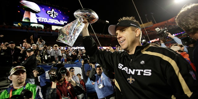 FILE - In this Feb. 7, 2010, New Orleans Saints coach Sean Payton holds the Vince Lombardi Trophy after the team's NFL Super Bowl 44 football game in Miami, Sunday, Feb. 7, 2010.