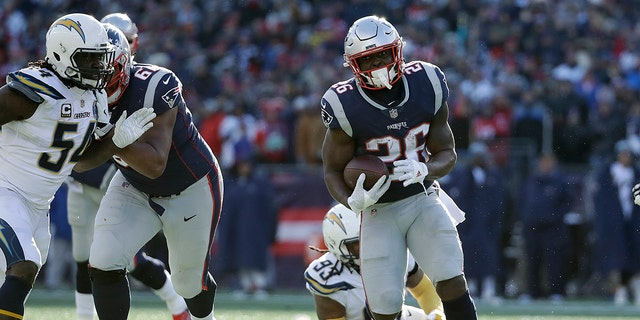 New England Patriots running back Sony Michel heads for the goal line and his second touchdown during the first half of an NFL divisional playoff football game against the Los Angeles Chargers.
