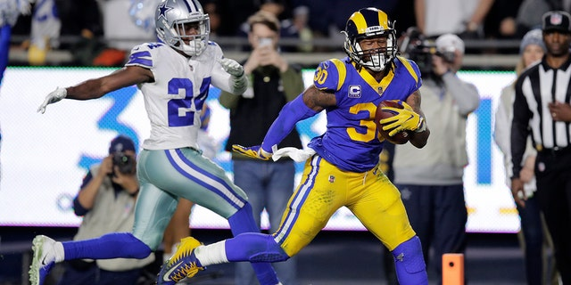 Los Angeles Rams running back Todd Gurley scores past Dallas Cowboys cornerback Chidobe Awuzie.