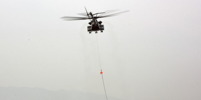 File photo - POHANG, Republic of Korea (March 29, 2016) An MH-53C assigned to Helicopter Mine Countermeasures Squadron (HM) 14 Detachment 2A links to an MK Magnetic Minesweeping System for Aircraft Mine Countermeasures (AMCM) exercises during Foal Eagle.