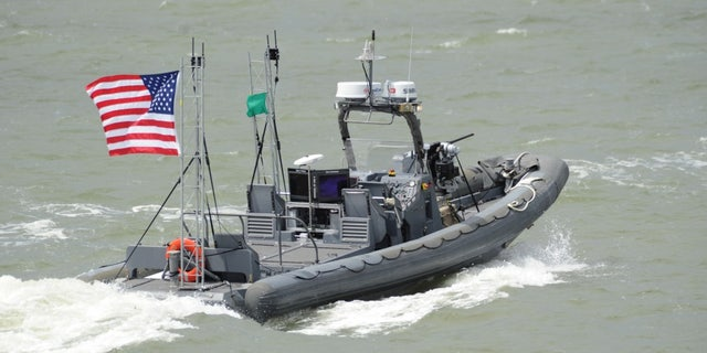 An unmanned 11-meter rigid-hull inflatable boat from Naval Surface Warfare Center Carderock on the James River in Newport News, Va.
