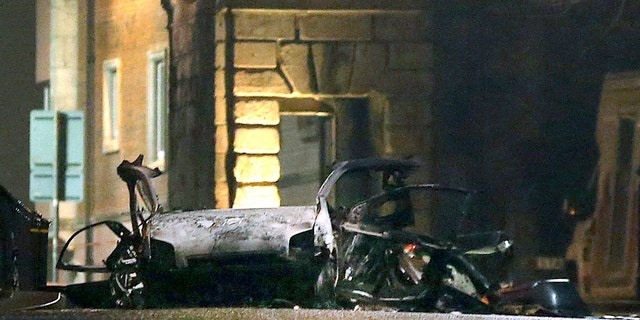 This photo taken on Saturday, Jan. 19, 2019 shows the scene of a suspected car bomb on Bishop Street in Londonderry, Northern Ireland.