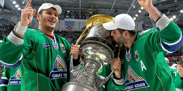 Oleg Saprykin, #91 of the Salavat Yulaev Ufa, and Alexander Radulov, #47 of the Salavat Yulaev Ufa, hoist the Gagarin Cup after the Salavat Yulaev Ufa defeated the Atlant Mytishchi 3-2 and won the Gagarin Cup in Game Five of the 2011 KHL Gagarin Cup Final on April 16, 2011 at the Arena Ufa in Ufa, Russia.