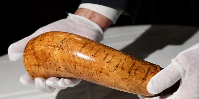 The Nowlin Powder Horn, carved for soldier Lt. Abel Prindel in 1757, is displayed during a news conference, Tuesday, Jan. 15, 2019, at the Dearborn Historical Museum in Dearborn, Mich. (Robin Buckson/Detroit News via AP)