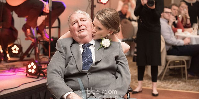The bride kisses her father on the dance floor. (Blue Room Photography)