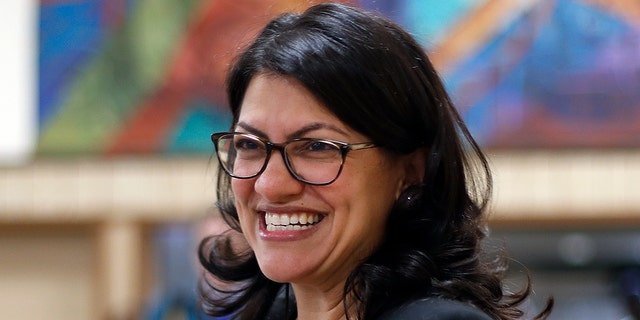Rashida Tlaib, Democratic candidate for the Michigan's 13th Congressional District, smiles during a rally in Dearborn, Mich., Friday, Oct. 26, 2018. (AP Photo/Paul Sancya)