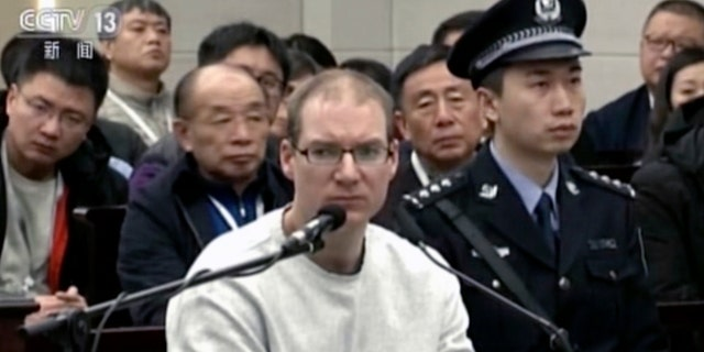In this image taken from a video footage run by China's CCTV Canadian Robert Lloyd Schellenberg attends his retrial at the Dalian Intermediate People's Court in Dalian northeastern China's Liaoning province on Monday Jan. 14 2019