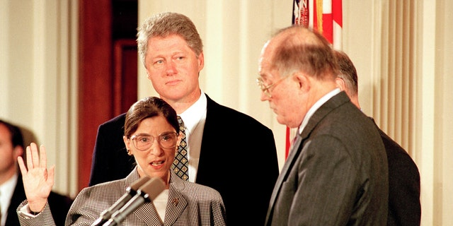 Supreme Court Chief Justice William Rehnquist, right, administers the oath to defend the Constitution to Ruth Bader Ginsburg as President Bill Clinton looks on in the East Room of the White House in Washington, D.C., Tuesday, Aug. 10, 1993. (Associated Press)