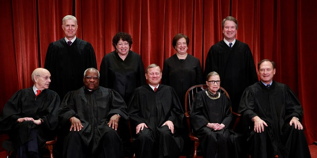 U.S. Supreme Court justices pose for their group portrait at the Supreme Court in Washington, U.S., November 30, 2018. Seated (L-R): Associate Justice Stephen Breyer, Associate Justice Clarence Thomas, Chief Justice of the United States John G. Roberts, Associate Justice Ruth Bader Ginsburg and Associate Justice Samuel Alito, Jr. Standing behind (L-R): Associate Justice Neil Gorsuch, Associate Justice Sonia Sotomayor, Associate Justice Elena Kagan and Associate Justice Brett M. Kavanaugh. REUTERS/Jim Young - RC1252A58870