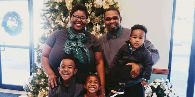 The Shaw family at Christmas: LaKenya, 38, Allen, 39, Josiah, 7, Naomi, 5, and Matthew, 2,