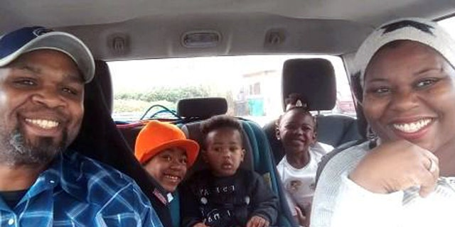 The Shaw family in their car.