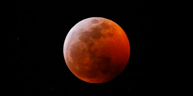 This photo shows the moon during a total lunar eclipse, seen from Los Angeles, Sunday Jan. 20, 2019.