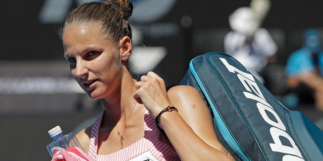 Karolina Pliskova of the Czech Republic leaves Rod Laver Arena after defeating United States' Serena Williams in their quarterfinal match at the Australian Open tennis championships in Melbourne, Australia, Wednesday, Jan. 23, 2019.