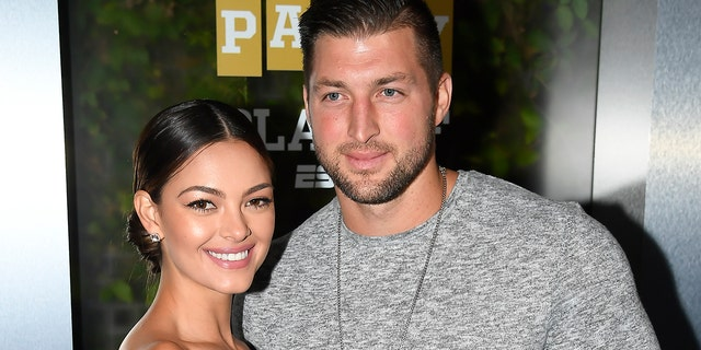 Miss Universe 2017 Demi-Leigh Nel-Peters and Tim Tebow of ESPN attend the Party At The Playoff at The GlassHouse on January 5, 2019.