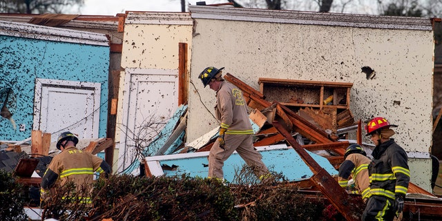 Rescue Workers search through damage after a tornado touchdown in Wetumpka, Ala., on Saturday, Jan. 19, 2019.
