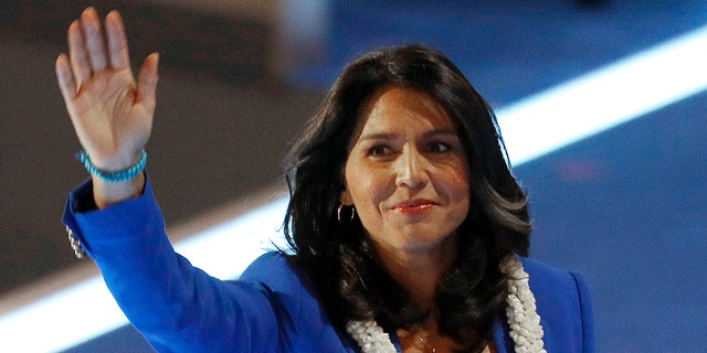 U.S. Representative Tulsi Gabbard (D-HI) waves after making a nomination speech for Senator Bernie Sanders at the Democratic National Convention in Philadelphia, Pennsylvania, U.S. July 26, 2016. REUTERS/Scott Audette
