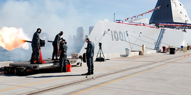 SAN DIEGO (Jan. 26, 2019) Sailors assigned to the Naval Base Coronado security department fire a 19-gun salute during the commissioning ceremony for the Zumwalt-class guided-missile destroyer USS Michael Monsoor (DDG 1001). (U.S. Navy photo by Mass Communication Specialist 1st Class Peter Burghart/Released)