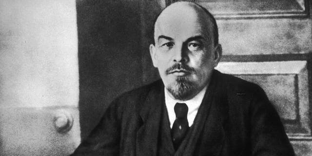 Portrait of Russian revolutionary leader Vladimir Lenin sitting at a table during a meeting of the Sovnarkom. (Photo by Hulton Archive/Getty Images)