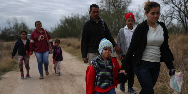 Migrant families from Central America seeking asylum walk down a dirt road after illegally crossing the Rio Grande into the U.S. from Mexico in Penitas, Texas, back in January. REUTERS/Adrees Latif - RC1AFBD3DDF0