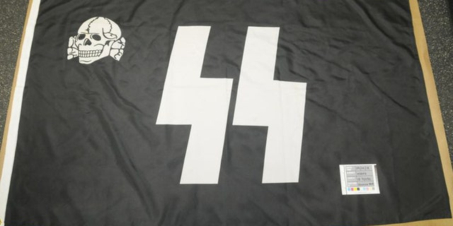 """Other items in Stolper's apartment included this SS flag, what appeared to be a Nazi calendar and a copy of Hitler's notorious autobiography, """"Mein Kampf."""""""