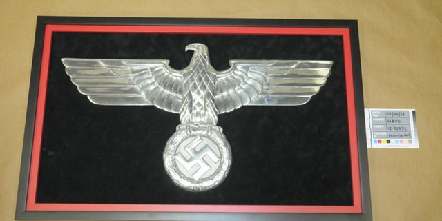 Police also found this Nazi eagle logo that was prominently displayed in Stolper's apartment.