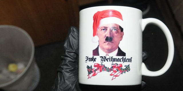 Inside Stolper's apartment, police found a trove of Nazi items including this mug featuring Adolf Hitler wearing a Santa hat.