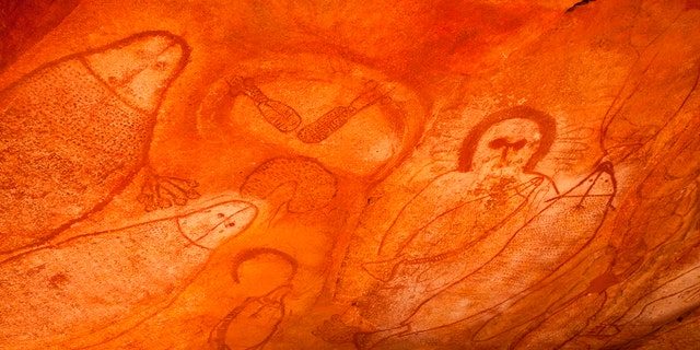Aboriginal cave paintings in rock shelter with Wandjina spirit figure and marine life. Raft Point Gallery, Kimberley Region, Western Australia, Australia. (Photo by: Auscape/UIG via Getty Images)