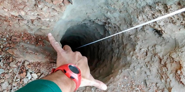 Rescuers believe the boy fell into the 100-meter-deep well after walking away from his parents.