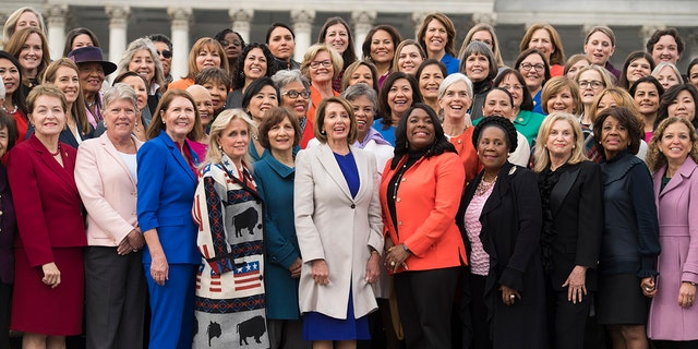UNITED STATES - JANUARY 04: Speaker Nancy Pelosi, D-Calif., center, poses with Democratic women members of the House after a group photo on the East Front of the Capitol on January 4, 2019. (Photo By Tom Williams/CQ Roll Call)