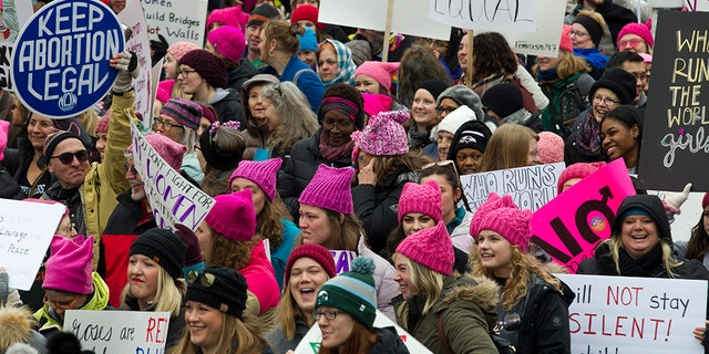 Demonstrators hold up their banners as they march on Pennsylvania Avenue during the Women's March in Washington on Saturday.