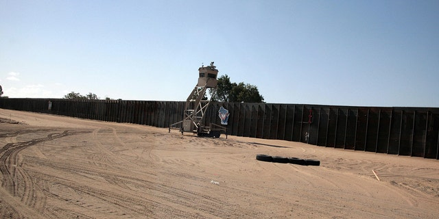 An observation tower rests near the border fence at the Yuma Border Sector on the US/Mexico border in San Luis, Arizona.