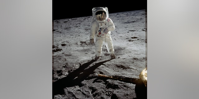 Astronaut Buzz Aldrin in his iconic Apollo spacesuit poses for a portrait on the moon during the Apollo 11 lunar landing mission in July 1969.