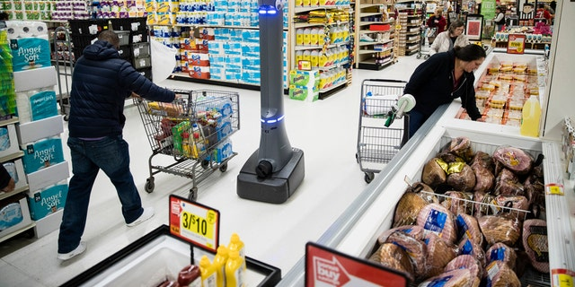 FILE- In this Jan. 15, 2019, file photo a robot named Marty cleans the floors at a Giant grocery store in Harrisburg, Pa. (AP Photo/Matt Rourke, File)