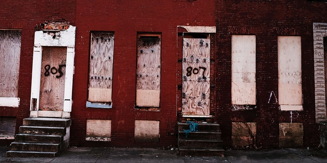 BALTIMORE, MD - FEBRUARY 03: Abandoned buildings stand in a neighborhood with a high murder rate on February 3, 2018 in Baltimore, Maryland.