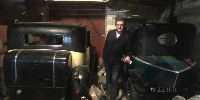 Artcurial director Matthieu Lamoure was with the team that recoverd the Bugattis along with the Citroen Torpedo he is leaning on in this photo.
