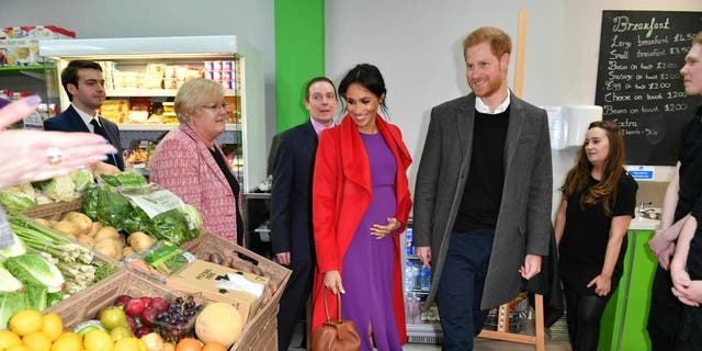 Britain's Prince Harry and Meghan, Duchess of Sussex officially open Number 7, a 'Feeding Birkenhead' citizens supermarket and community cafe, at Pyramids Shopping Centre, as part of a visit to Birkenhead, northwest England, Monday Jan. 14, 2019. (Anthony Devlin/Pool via AP)