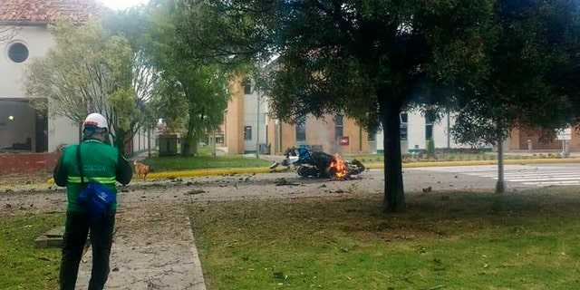 In this image provided by military personnel, flames rise from a deadly car bombing at a police academy on Thursday, in Bogota, Colombia. (AP Photo)