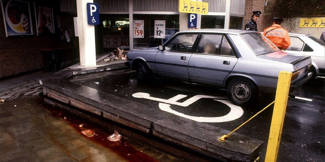 """View of the parking lot of a Delhaize supermarket in Alost November 10, 1985, the day after an attack by the """"Brabant killers"""". Police have failed to solve the """"Brabant Killings"""" when a band of gunmen sowed terror in central Belgium between 1983 and 1985 by attacking supermarkets and indiscriminately shooting customers. At least 28 people died in the attacks. OUT - PBEAHUNEZCQ"""