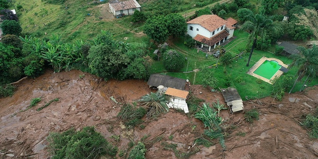 An aerial view shows a partially destroyed house after a dam collapsed, in Brumadinho, Brazil, Saturday, Jan. 26, 2019. (Associated Press)
